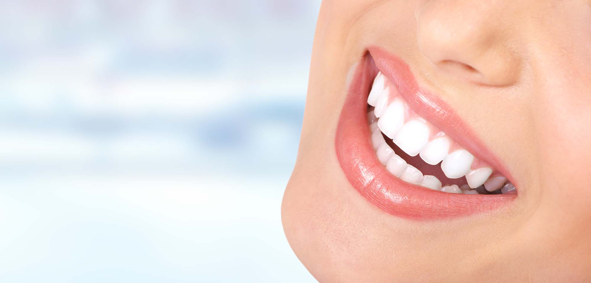 Beautiful young woman smile close-up. Dental health care